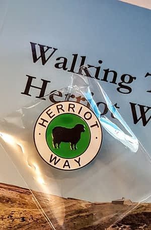 Herriot Way pin badge with walking guide book