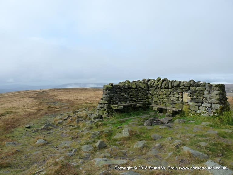 Cross shelter and views from a clear Great Shunner Fell